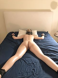 Naughty girls tied to bed